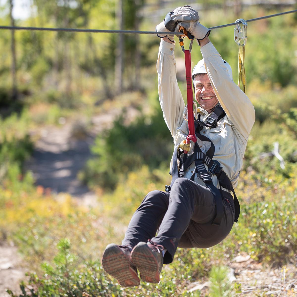 Guest enjoying zipline thrill