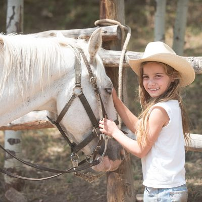 Little girl in love with her horse