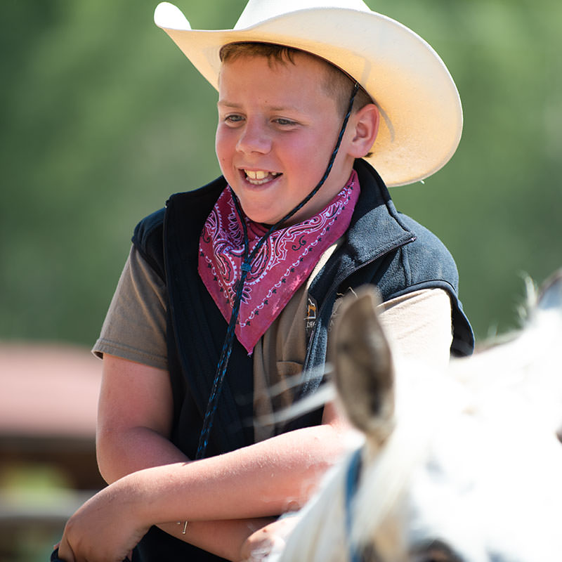 Smiling young cowboy