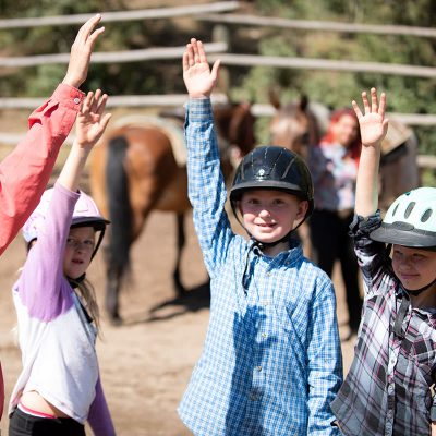 Little girls happily participating in riding program