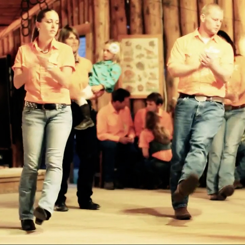 Evening line dance group activity in the dance hall