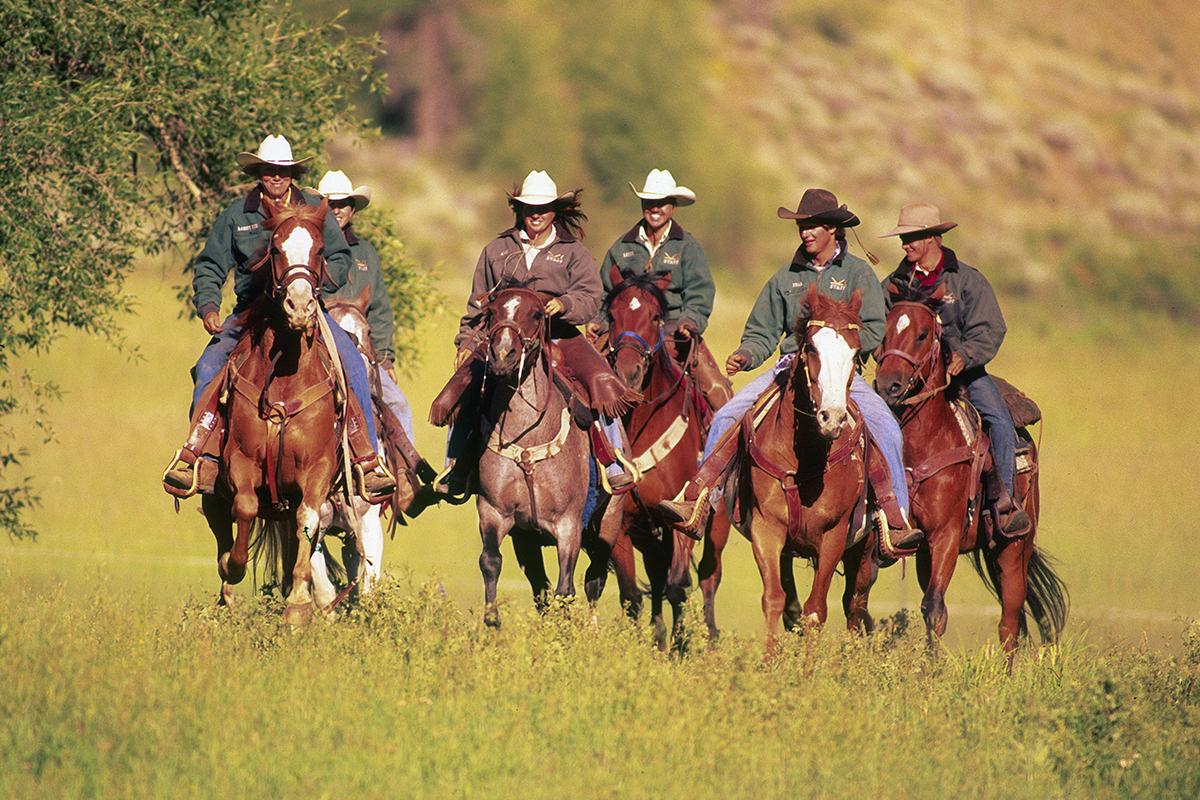 The Fosha Family Riding across the Ranch